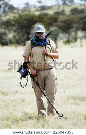 AUSTRALIA - MAY 6: Gold miner in the Australian outback prospecting area in the bush with his metal detector looking for gold nuggets, may 6, 2007. - stock photo
