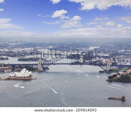 Australia NSW Sydney City landmarks including aerial view on harbour and the bridge day time summer helicopter flight - stock photo