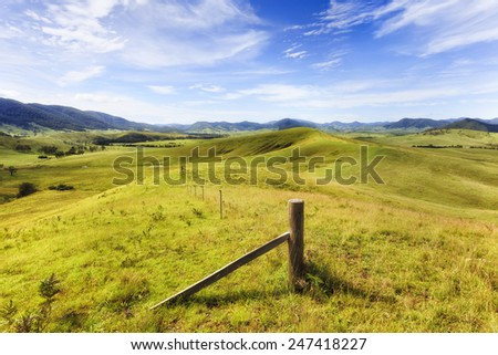 Australia regional NSW rural landscape of grazing cultivated agricultural land in Barrington tops region developed for cattle growing  - stock photo