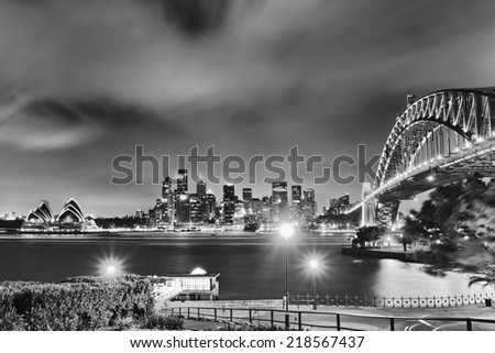 Australia Sydney city landmarks high-rise skyscrapers and sydney harbour bridge after sunset illuminated black-white  - stock photo