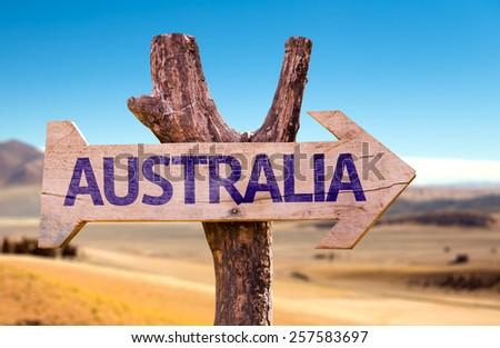 Australia wooden sign with desert background - stock photo