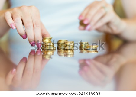 Australian Currency - Lady counting coins - stock photo