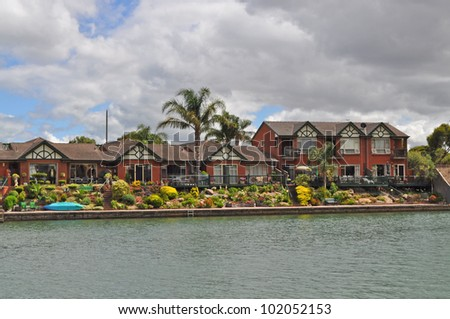 Australian family houses on the lake. - stock photo