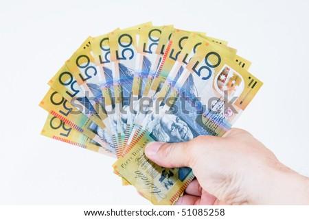 Australian fifty dollar notes in hand. - stock photo