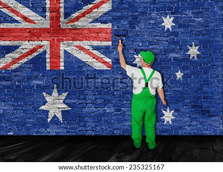Australian flag painted over old brick wall by house painter - stock photo