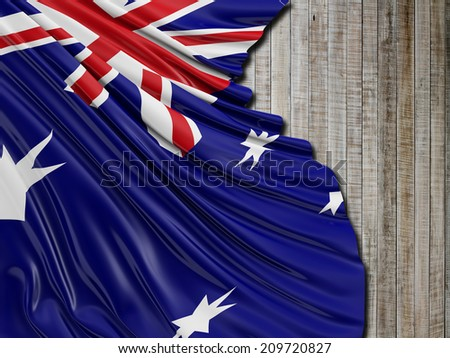 Australian Folded Flag with vertical wood - stock photo