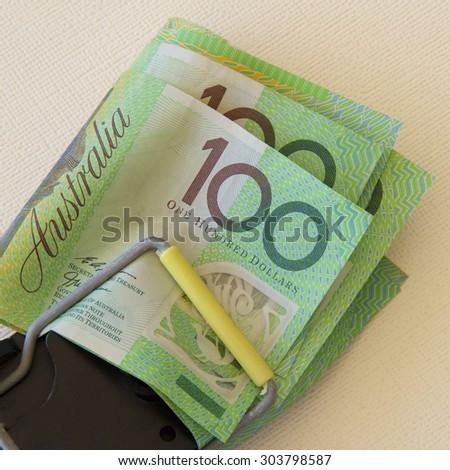 Australian hundred dollar notes in a trap. - stock photo