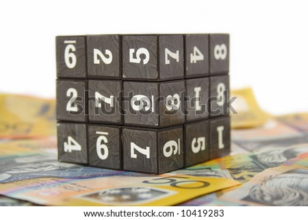 Australian money and cube with numbers - stock photo