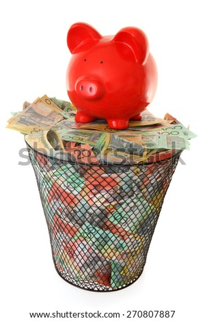 Australian Money and piggy bank in waste paper basket - stock photo