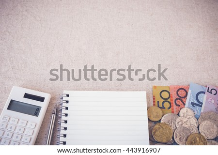 Australian money, AUD with calculator, notebook selective focus toning copy space background - stock photo