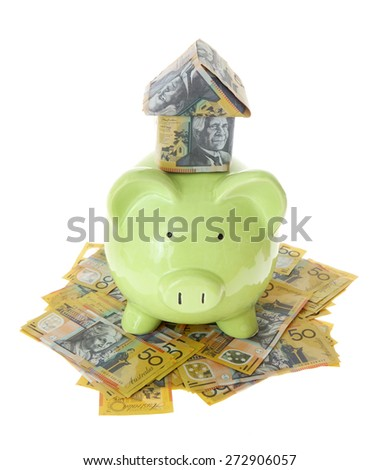 Australian Money - Aussie currency with piggy bank and house - stock photo