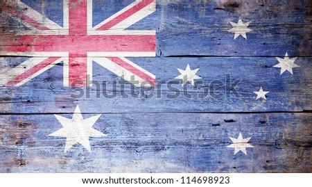 Australian National Flag painted on grungy wood plank background - stock photo