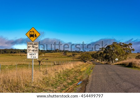 Australian outback road with school bus stop sign. Unmarked rural path. Myrtleville NSW, Australia - stock photo