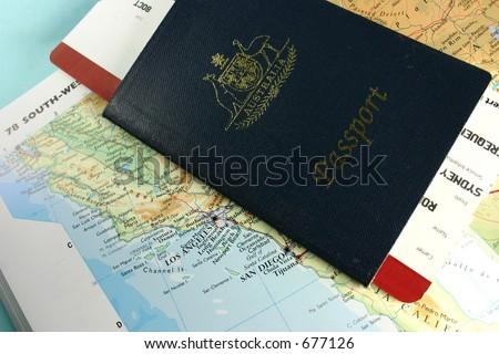 Australian passport, with flight boarding pass, on map of USA west coast - stock photo