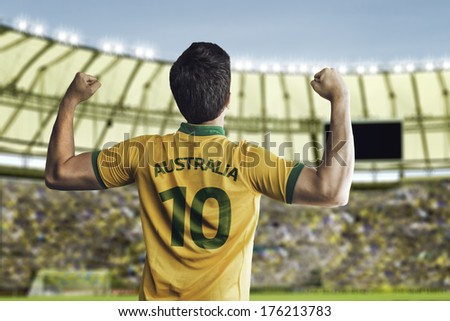 Australian soccer player celebrates with the fans on the stadium - stock photo