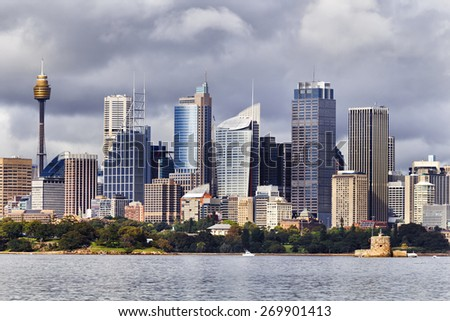 Australian Sydney landmark - city CBD high rises and towers forming megapolis cityscape summer day from harbour - stock photo