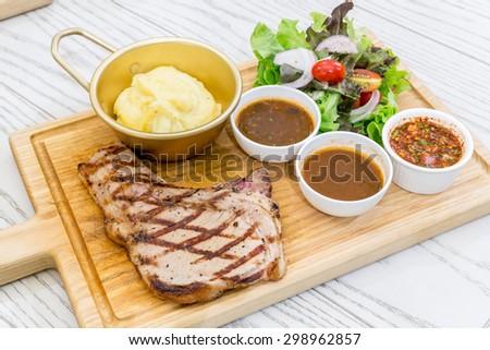 australian t-bone beef steak serve with fresh vegetable - stock photo