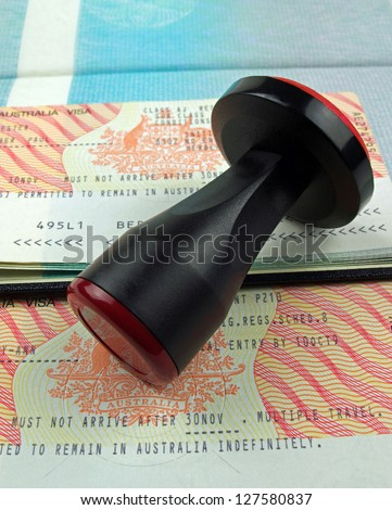 Australian visas and rubber stamp - stock photo