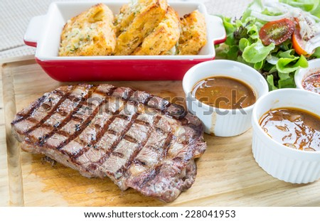 australian wagyu rib-eye beef steak serve with fresh vegetable - stock photo