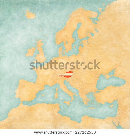 Austria (Austrian flag) on the map of Europe. The Map is in vintage summer style and sunny mood. The map has a soft grunge and vintage atmosphere, which acts as watercolor painting on old paper.  - stock photo