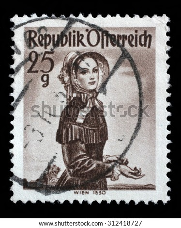 AUSTRIA - CIRCA 1948: A stamp printed in Austria from the Provincial Costumes issue shows a woman from Vienna (1850), circa 1948. - stock photo