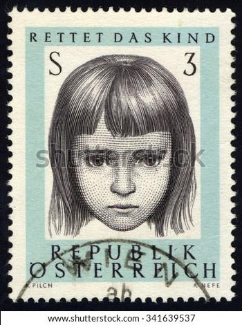 AUSTRIA - CIRCA 1966: A stamp printed in Austria to commemorate Austrian Organisation 'Rettet das' Kind shows Portrait of Little Girl, circa 1966 - stock photo