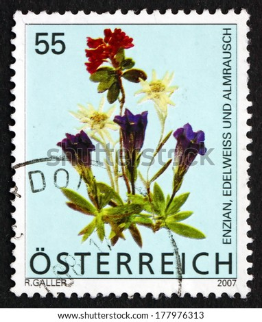AUSTRIA - CIRCA 2007: a stamp printed in the Austria shows Alpine Rose, Edelweiss and Blue Gentian, Flowers, circa 2007 - stock photo