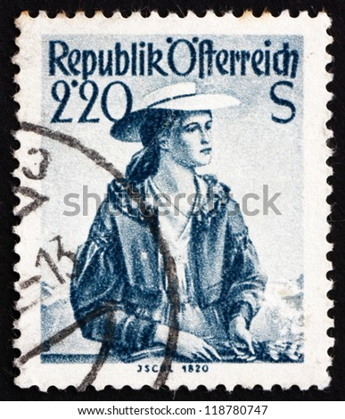 AUSTRIA - CIRCA 1952: a stamp printed in the Austria shows Woman from Ischl, 1820, Regional Costume, circa 1952 - stock photo