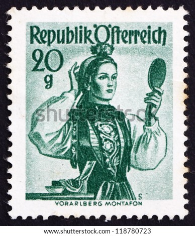 AUSTRIA - CIRCA 1948: a stamp printed in the Austria shows Woman from Vorarlberg, Montafon Valley, Regional Costume, circa 1948 - stock photo