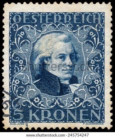 AUSTRIA - CIRCA 1922: Stamp printed in Austria shows a portrait of Wolfgang Amadeus Mozart, circa 1922.  - stock photo