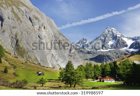 Austria ,September 2015 :Mountain valley with Grosglockner peak in background. - stock photo