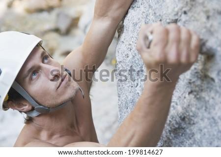 Austria, Steiermark, Ramsau, Silberkarklamm, Man rock climbing, close up - stock photo