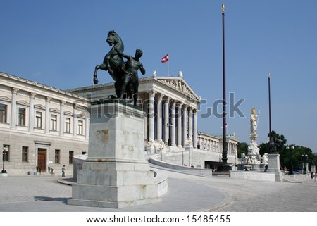 Austrian Parliament building with statue of Athena - stock photo