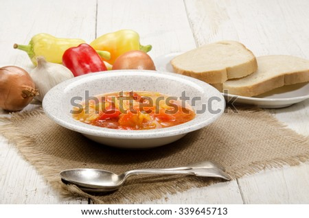 authentic hungarian letscho with sweet peppers, onion, garlic and bread - stock photo