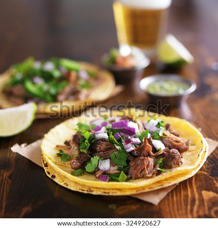authentic mexican street tacos with barbacoa beef on yellow corn tortilla - stock photo
