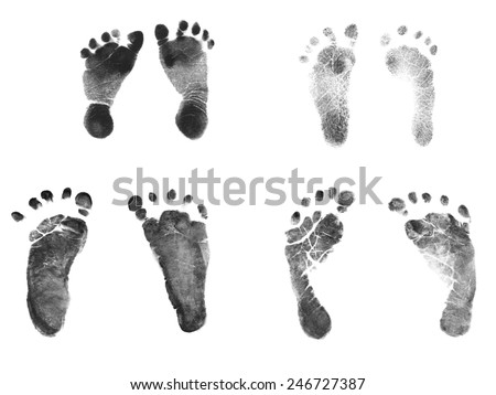 Authentic Newborn Baby Ink Footprints - Normal 7 pound baby and 2 pound premature baby birth weight footprints - stock photo