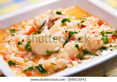 Authentic portuguese food: Delicious soup-like rice with codfish - stock photo