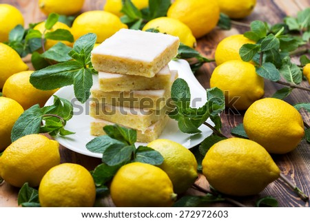Authentic Shortcake Cake, a lot of fresh yellow lemons and mint. Morning atmospheric lighting, fashionable trendy spot soft focus. Preparation for design creative menu. - stock photo