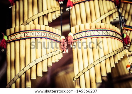 Authentic south american panflutes  in local market in Peru. - stock photo