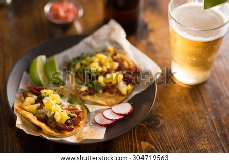 authentic street tacos and beer on plate with copy space - stock photo