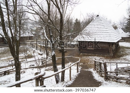 """authentic ukrainian village with wooden huts and fence in """"Old Village"""" museum in west Ukraine - stock photo"""