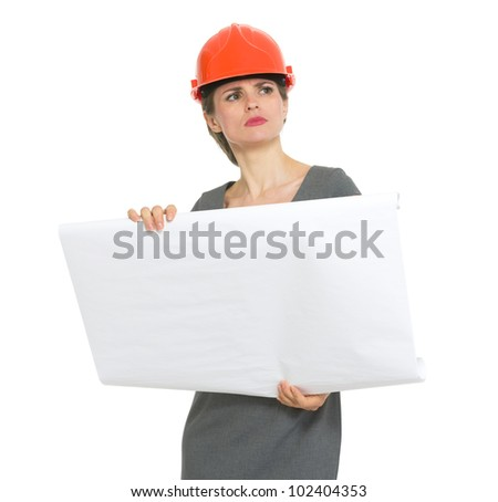 Authoritative architect woman with flipchart looking into distance - stock photo