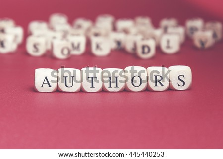 Authors word written on wood cube with red background - stock photo