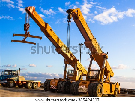 auto cranes on construction site - stock photo