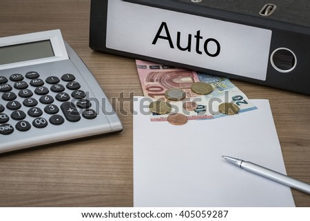 Auto (german Car) written on a binder on a desk with euro money calculator blank sheet and pen - stock photo