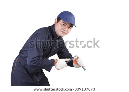 Auto mechanic holding wrench for working in garage repair service  isolated on white background with clipping path - stock photo