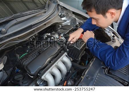Auto mechanic (or technician) fixing car engine - soft focus - stock photo