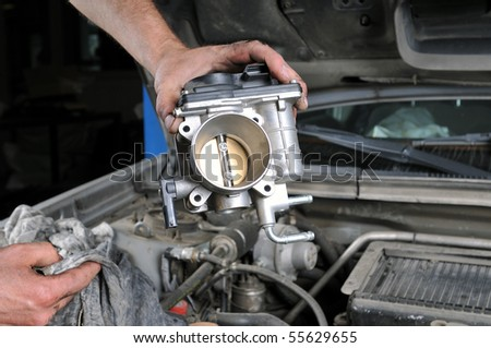 Auto mechanic's hands working on car - a series of MECHANIC related images. - stock photo