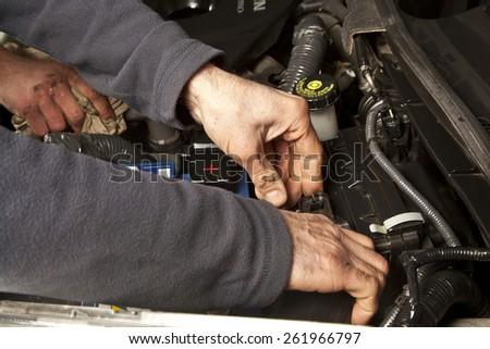 Auto mechanic working in garage. Repair service. - stock photo