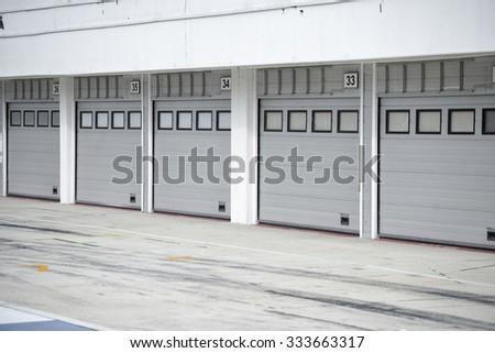 Auto - motor speedway garage - stock photo